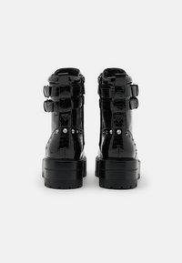 Guess - FLORICE - Cowboy/biker ankle boot - black - 3