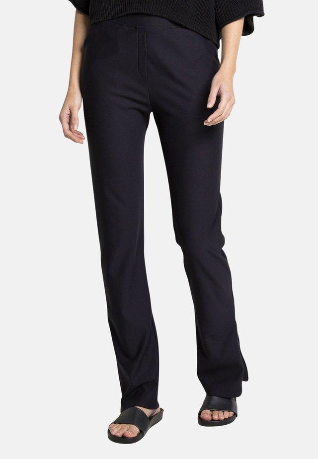 LEVI - Trousers - black
