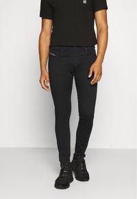 Diesel - D-STRUKT - Jeans Tapered Fit - black denim - 0
