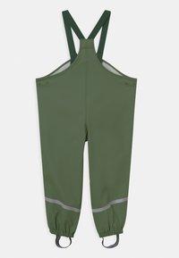 Lindex - MINI RAIN TROUSERS UNISEX - Rain trousers - dusty green - 1