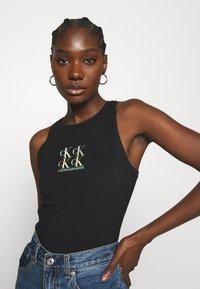 Calvin Klein Jeans - SHINE LOGO RACER BACK - Top - black - 0