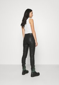 Diesel - D-OLLIES-BK-SP-NE JOGGJEANS - Slim fit jeans - black - 2