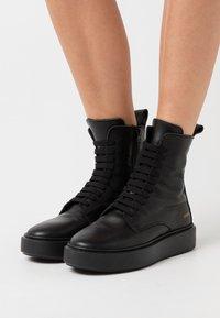 Copenhagen - CPH453 - Kotníkové boty na platformě - black - 0