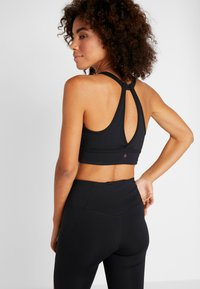 Under Armour - RUSH BRA - Sports bra - black/tonal - 2