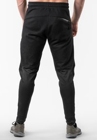 Reeva - Trainingsbroek - black - 2