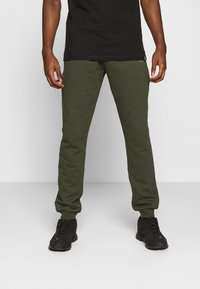 Carlo Colucci - PANT - Tracksuit bottoms - green - 0
