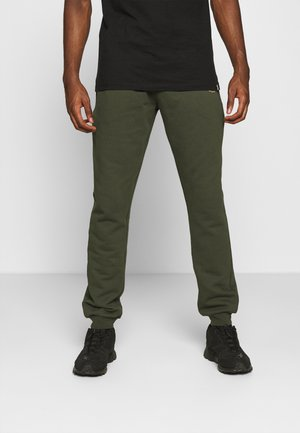 PANT - Tracksuit bottoms - green