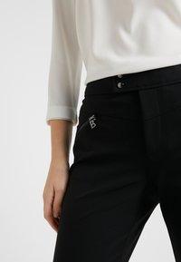 Bogner - LINDY - Spodnie materiałowe - black - 4