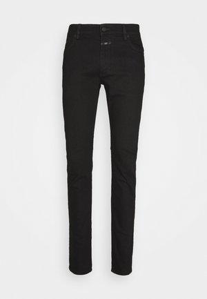UNITY - Slim fit jeans - black