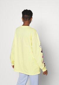 NEW girl ORDER - SLEEVE PRINT - Long sleeved top - yellow - 2