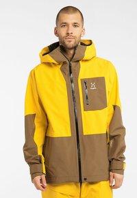 Haglöfs - LUMI JACKET - Ski jacket - pumpkin yellow/teak brown - 0