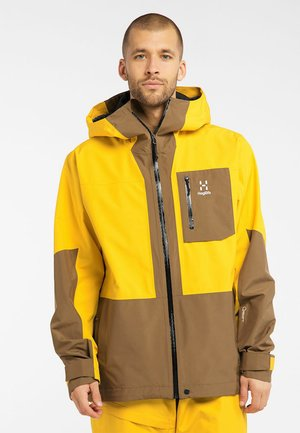 LUMI JACKET - Ski jacket - pumpkin yellow/teak brown