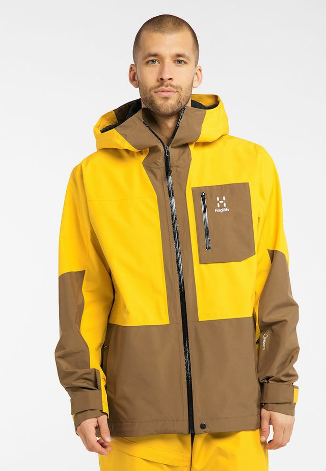 LUMI JACKET - Ski jacket - pumpkin yellow/teak brown