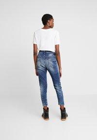 Diesel - FAYZA-NE JOGGJEANS - Relaxed fit jeans - indigo - 2