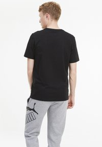 Puma - T-shirt con stampa - black - 2