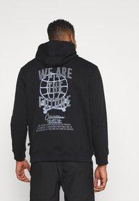 Common Kollectiv - FUTURE HOOD UNISEX  - Sweatshirt - black - 2