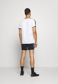 Puma - Sports shorts - black/asphalt - 2