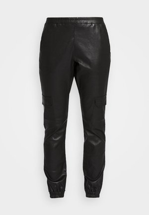 MARGOT - Leather trousers - black