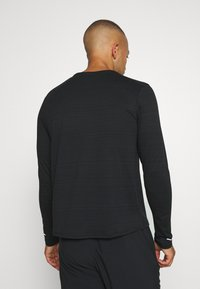 Nike Performance - MILER - Sports shirt - black/silver - 2