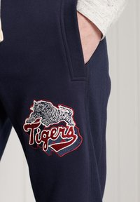 Superdry - Tracksuit bottoms - nautical navy - 2