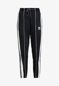 adidas Originals - TRACK PANTS - Träningsbyxor - black - 4