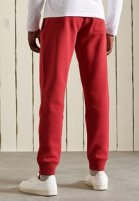 Superdry - Tracksuit bottoms - rich red marl - 1