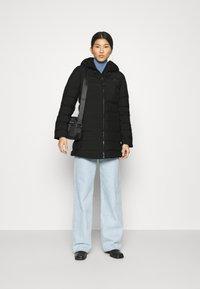 Tommy Hilfiger - SEAMLESS SORONA COAT - Light jacket - black - 1