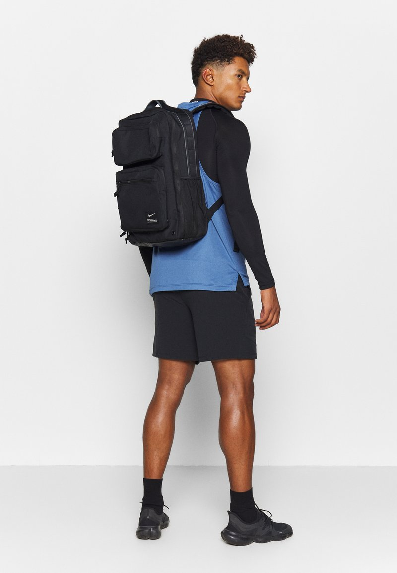 Nike Performance - UTILITY SPEED UNISEX - Rucksack - black/enigma stone