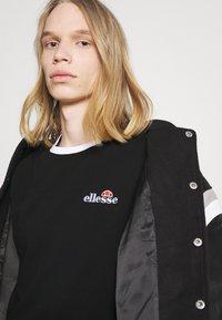 Ellesse - MEDUNO TEE - T-shirt imprimé - black - 3