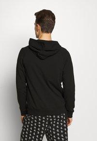 Calvin Klein Underwear - CK ONE FULL ZIP HOODIE  - Pyjama top - black - 2
