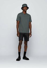 BOSS - KURZARM - Polo shirt - dark green - 1