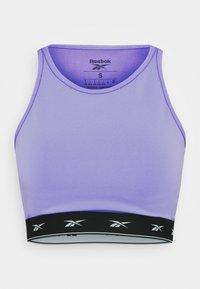BEYOND THE SWEAT CROP - Medium support sports bra - hyper purple