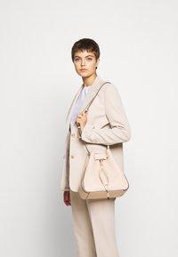 HUGO - VICTORIA - Across body bag - pink - 0
