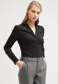 Vero Moda - VMLADY - Button-down blouse - black - 0