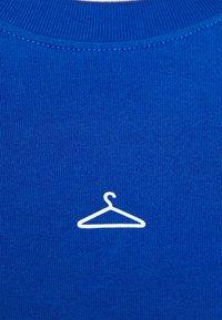 Holzweiler - HANGER LONGSLEEVE - Long sleeved top - blue - 7