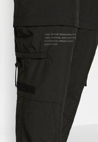 Puma - FIRST MILE 2IN1 PANT - Jogginghose - black - 6