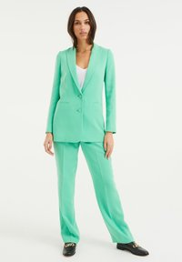 WE Fashion - Trousers - bright green - 1