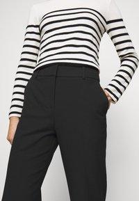 Claudie Pierlot - PATEL - Trousers - noir - 3