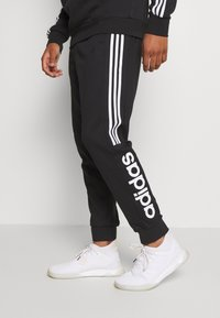 adidas Performance - ESSENTIALS TRAINING SPORTS PANTS - Spodnie treningowe - black/white - 0