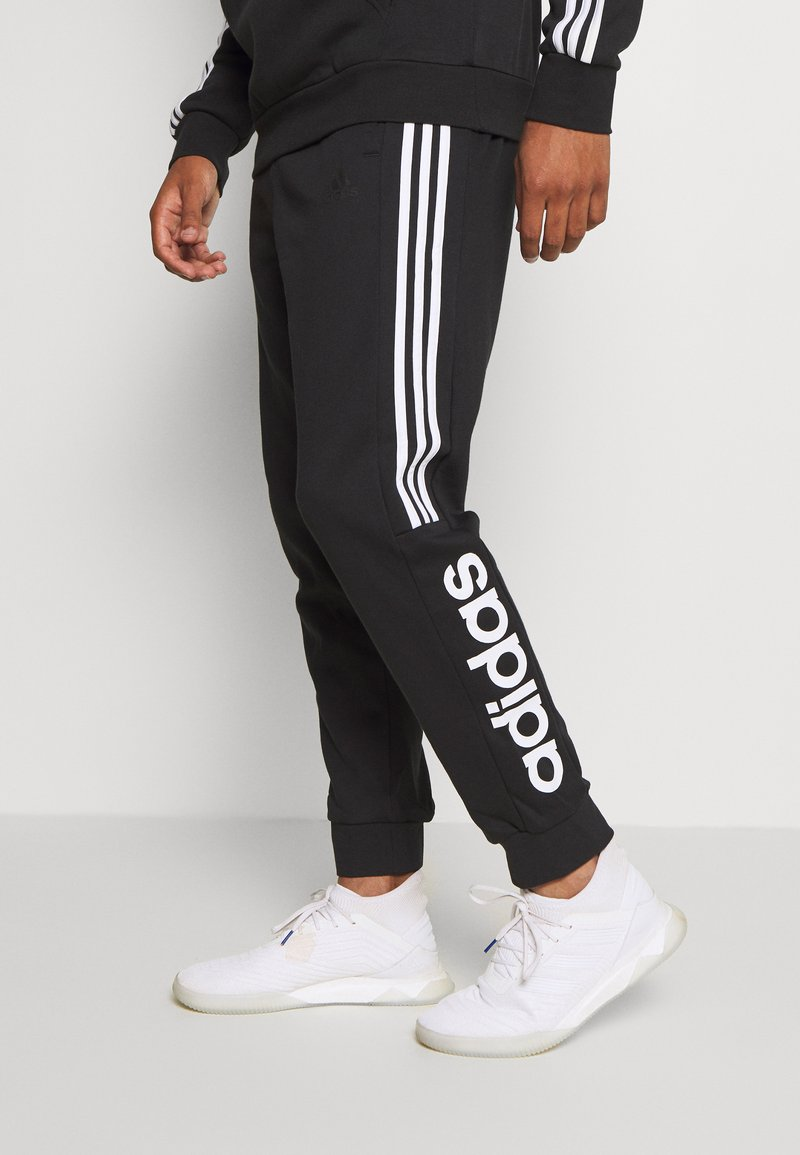 adidas Performance - ESSENTIALS TRAINING SPORTS PANTS - Teplákové kalhoty - black/white