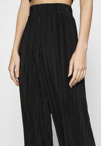Monki - SEVERINA TROUSERS - Trousers - black dark - 5