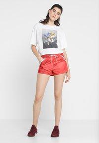 Craft - DISTRICT HIGH WAIST SHORTS - kurze Sporthose - red/orange - 1