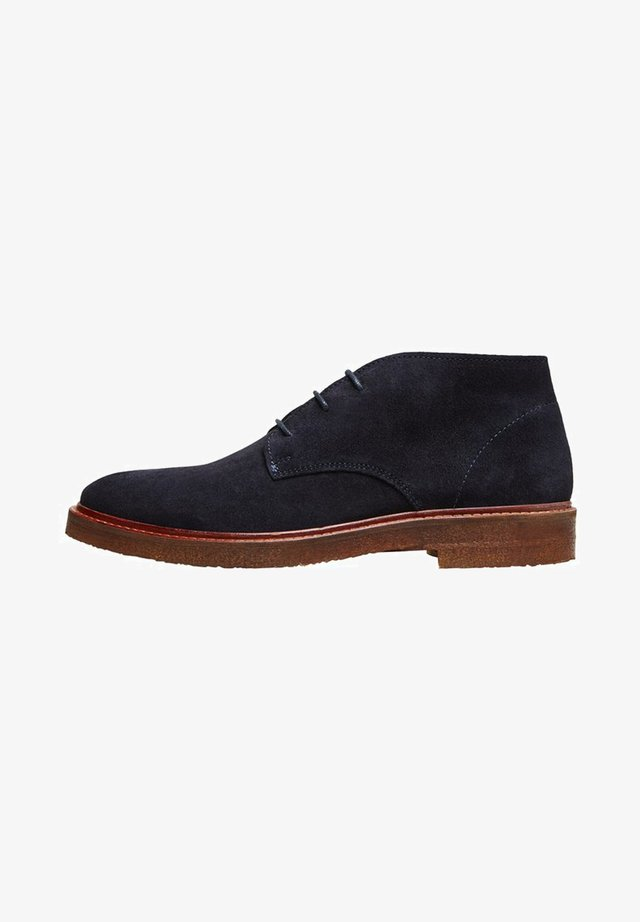 CHUKKA - Lace-up ankle boots - sky captain