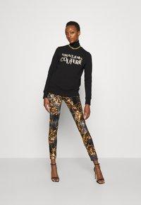 Versace Jeans Couture - PANTS - Legginsy - black/gold - 5