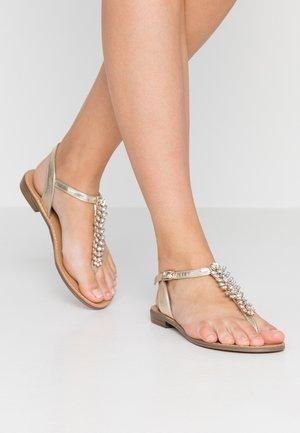 Sandály s odděleným palcem - gold