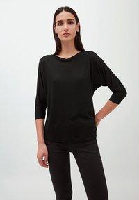 ARMEDANGELS - Long sleeved top - black - 0