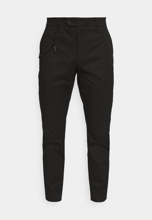 TROUSERS JAGGER CARROT FIT IN STRETCH FABRIC - Trousers - black