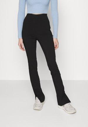 SUPER STRETCH SLIT PANTS - Leggings - Trousers - black