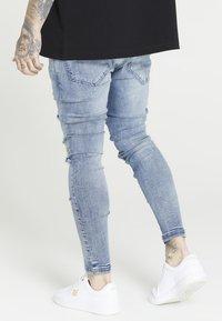 SIKSILK - RAW HEM BURST KNEE - Jeans Skinny Fit - rustic blue wash - 2