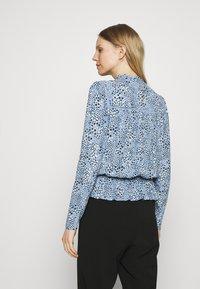Marks & Spencer London - STAR FRILL PEPLUM - Blouse - blue - 2